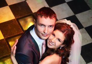 Photo of bride and groom dancing